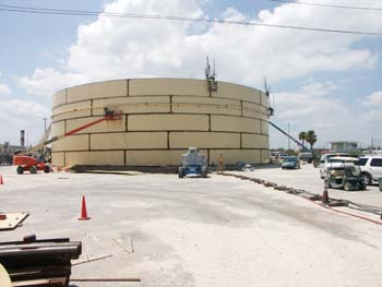 Vecellio Group VP of Safety John West and Vecenergy Safety Manager Glen Moll review diesel tank construction at South Florida Materials Corp.